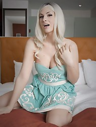 Blonde hottie Bailey Jay stripping on the bed