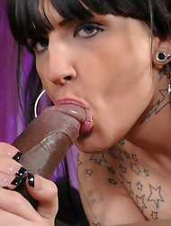 Horny Kelly Clare blowing a huge black cock