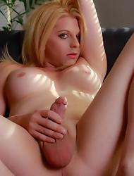 Blonde beauty Tyra strips & strokes