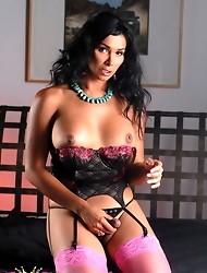 Seductive brunette transsexual Vaniity stripping in bed