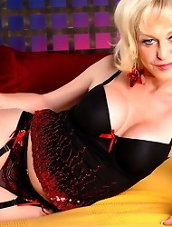 Beautiful transsexual Olivia Love posing on the bed