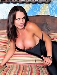 Hot long-legged transsexual posing her huge dick